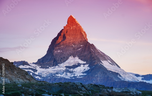 Poster Bergen Matterhorn peak during sunrise. Beautiful natural landscape in the Switzerland. Mountains landscape at the summer time