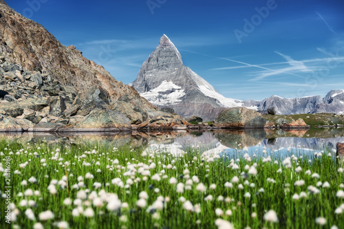 Aluminium Prints Dark grey Matterhorn and and grass near lake at the morning time. Beautiful natural landscape in the Switzerland. Mountains landscape at the summer time