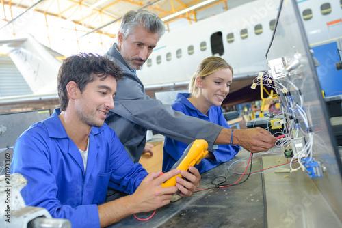Photo examining an aircraft