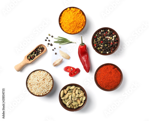 Fototapeta Composition with different aromatic spices on white background, top view obraz