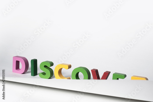 DISCOVER word made of colorful letters. Partially covered DISCOVER