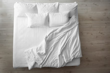 Comfortable Bed With Soft Pillows Indoors, Top View