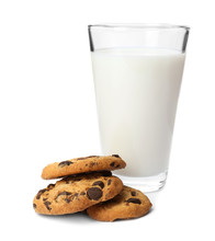 Tasty Cookies With Chocolate Chips And Glass Of Milk On White Background