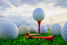 Close Up The Golf Ball On Tee Pegs Ready To Play And On Green Grass In The Nature Background