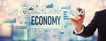 Economy With Businessman On Blurred Abstract Background