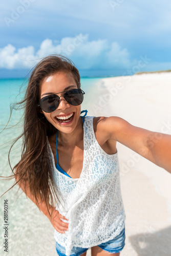 4cd25a08b7e Beach selfie young Asian woman taking fun photo with phone on Caribbean  tropical summer holidays.