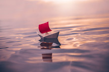 Paper Boat With Red Sail Float...