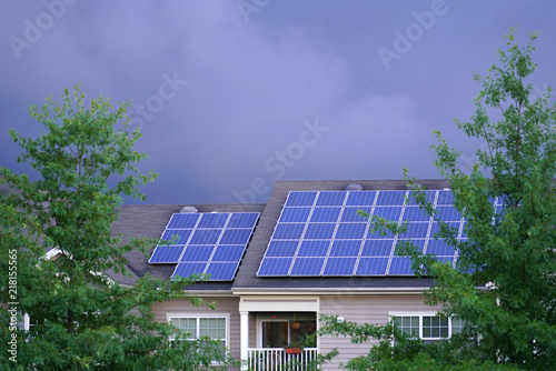 solar panel installed on the apartment roof in storm day Canvas Print