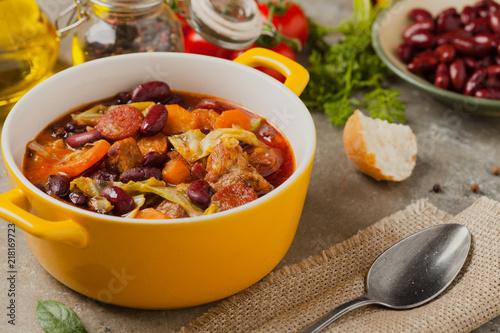 Foto  Traditional portuguese goulash with cabbage, beans and ribs.