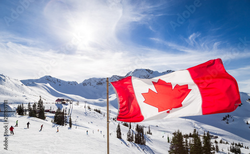 Spoed Foto op Canvas Canada Canadian flag flying near the Rendezvous on top of Whistler Mountain.