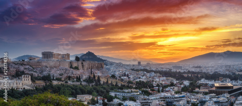 Foto auf Leinwand Athen Panorama view on Acropolis in Athens, Greece, at sunrise. Scenic travel background with dramatic sky.