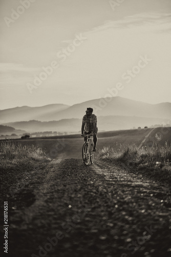 Fototapety do przedpokoju  young-man-with-retro-bicycle-in-sunset-on-the-road-fashion-photography-on-retro-style-with-bike
