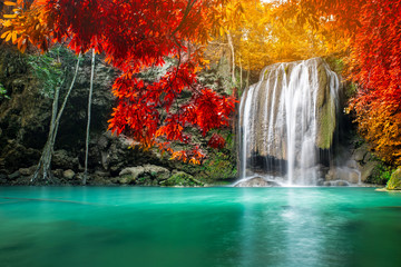 FototapetaAmazing beauty of nature, waterfall at colorful autumn forest
