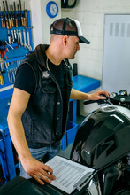 Mechanic Checking Motorcycle A...