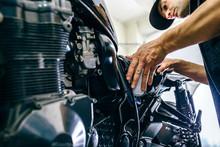 Mechanic Repairing Customized ...