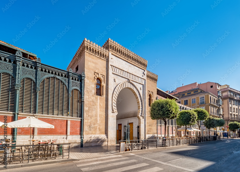 Fototapety, obrazy: Panorama view of the Arabic marble arch, entrance of the Atarazanas food market in the historic centre of the city of Malaga, Spain