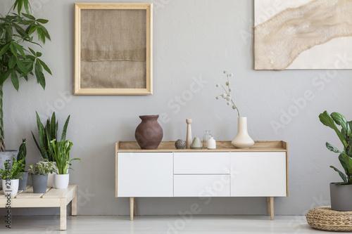 Αφίσα  Real photo of a botanic living room interior with burlap artwork on the gray wal