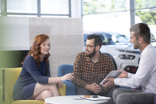 Fototapeta Professional car dealer offering luxurious vehicles during meeting with buyers i
