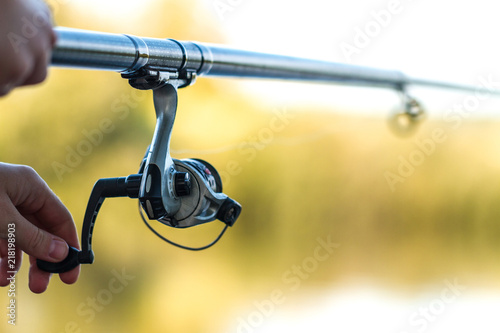 Fishing rod close-up. Fishing on the lake. Fishing tackle Wallpaper Mural