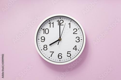 Fototapeta wall clock at abstract background obraz