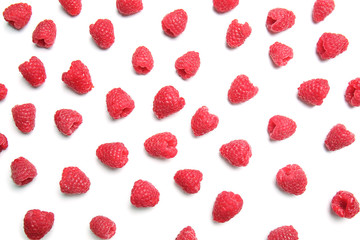 Fresh ripe raspberries on white background