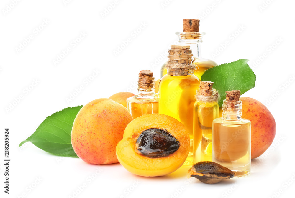 Fototapety, obrazy: Bottles of apricot essential oil on white background
