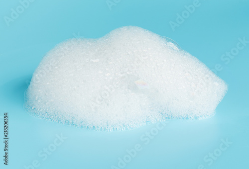 Fotografie, Obraz Soap foam bubble isolated on blue background object beatuy health care concept