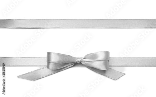 Fotografiet Silver ribbons with bow on white background