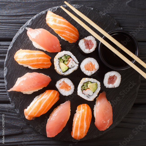 Japanese sushi on a rustic dark background. Sushi rolls, nigiri, maki, soy sauce. Sushi set on a table. Asian food. top view from above