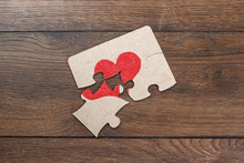 Parts Of The Puzzle Form The Heart, Broken. The Concept Of Divorce, Quarrel, Conflict.