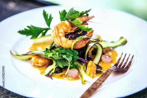 Modern food stylist decorating meal for presentation in restaurant. Closeup of food stylish. Restaurant serving - 218231190