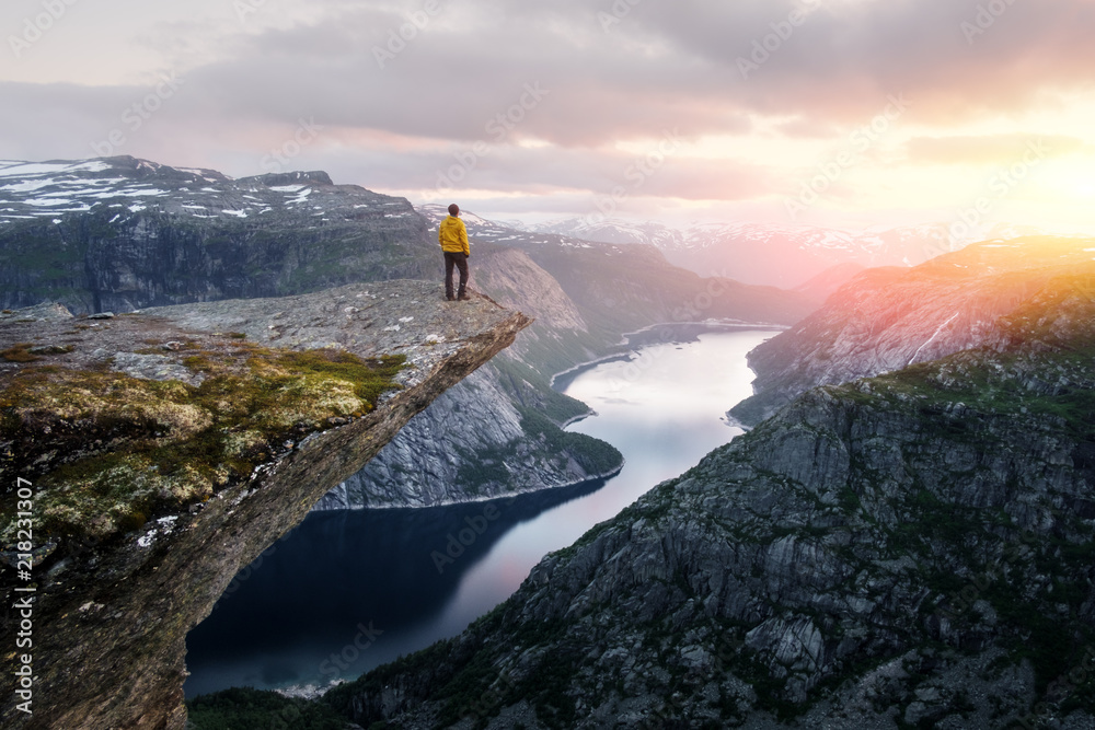 Fototapety, obrazy: Alone tourist on Trolltunga rock - most spectacular and famous scenic cliff in Norway