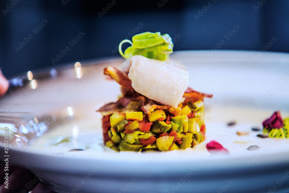 Fototapety, obrazy: Modern food stylist decorating meal for presentation in restaurant. Closeup of food stylish. Restaurant serving
