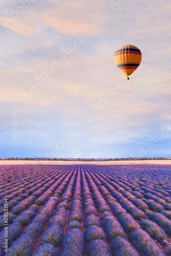 travel destination, beautiful dream inspirational landscape with hot air balloon flying above lavender fields in Provence, tourism in France