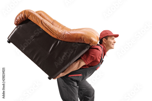 Poster  Mover carrying a leather armchair on his back