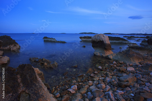 Photographie  long exposure of sea and rocks