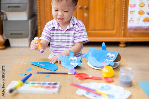 Happy Cute Little Asian 2 Years Old Toddler Boy Child Enjoying Doing
