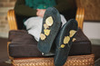 Yellow leaves on soles of room slippers
