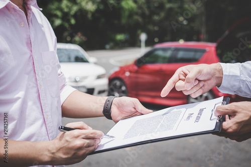 Insurance Agent examine Damaged Car and customer filing