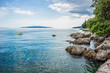 tropic resort sea waterfront nature scenery landscape concept of blur water surface with small boat and empty space for copy or text