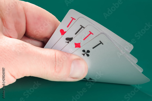 фотография  playing cards in hand, four aces