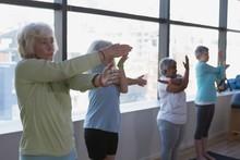 Group Of Senior Women Performing Yoga