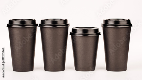 black paper cups on white background.