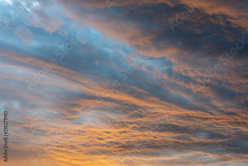 Foto  Beautiful dramatic african sunset with clouds on fire shining orange
