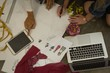 Fashion designers drawing a sketch using digital tablet