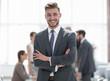 happy businessman standing in modern office