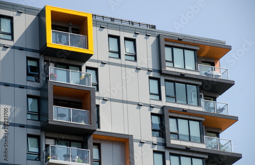 Papel de parede Yellow highlights in exterior of a condo building in Victoria downtown