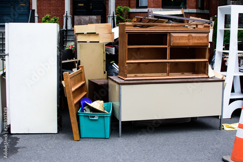 Cuadros en Lienzo Items and old furniture on street outside house moving day or getting rid of jun