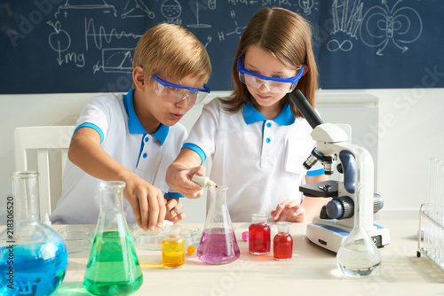 Fotografie, Obraz  Little scientists adding color dye into beakers