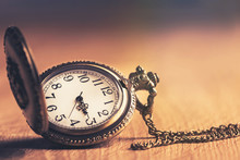 Pocket Watch On Wooden  Table ...